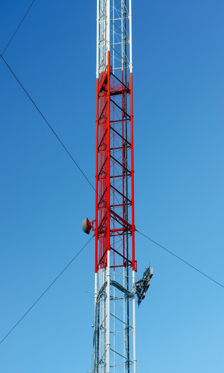white and red satellite tower